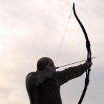 Archer firing arrow