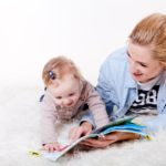 Parents and children have fun reading together.